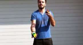 Solving Rubik's Cube While Juggling 2 Others